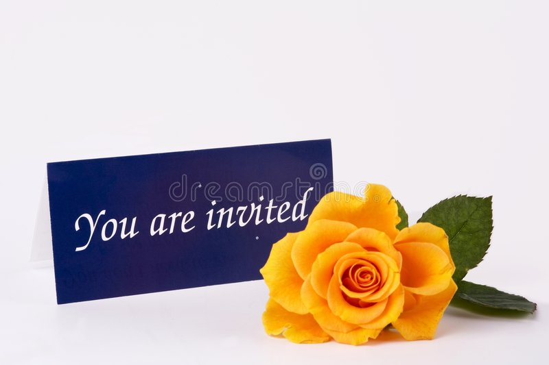You are invited. Invitation card and yellow rose on table royalty free stock images