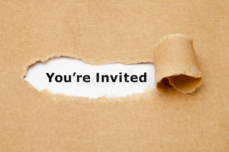 You Are Invited Torn Paper Concept. Text You Are Invited appearing behind torn brown paper. Invitation concept royalty free stock photography