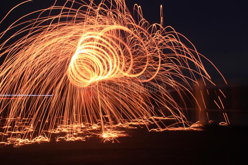 Steelwool make a fireworks in Midnight. You just need to believe. You have to believe it.nThere is no coincidences in this world.nYesterday has become the past royalty free stock image