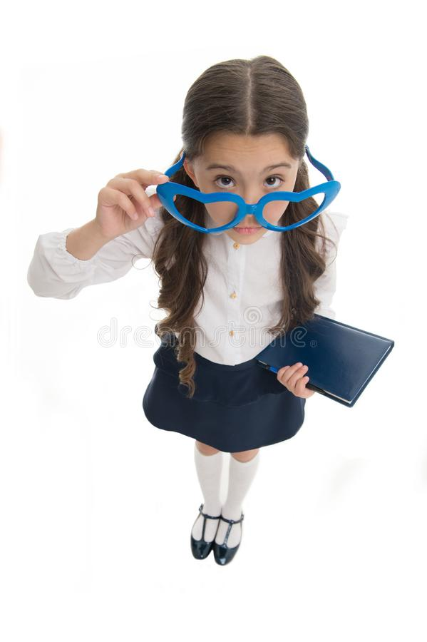 Are you kidding me. Schoolgirl heart shaped glasses isolated white background. Child girl school uniform clothes picking royalty free stock photos