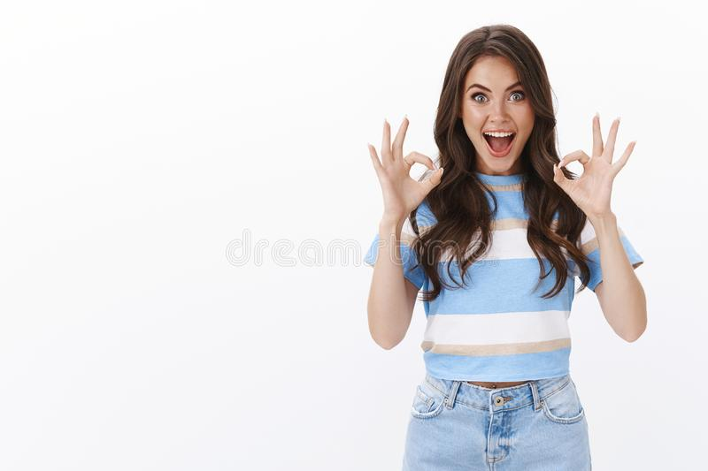 You look perfect. Cheerful amused good-looking glamour woman judging awesome sister outfit, smiling excited and royalty free stock image