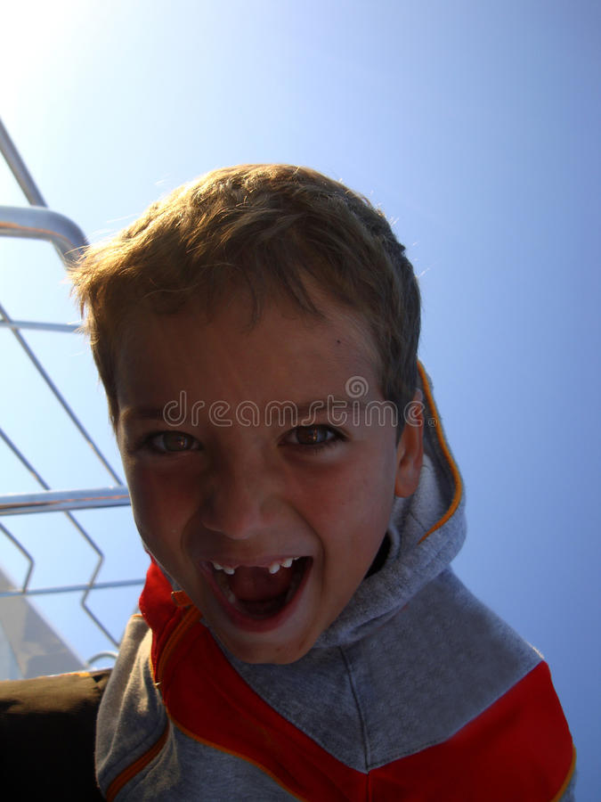 When you loosing your teeth... You can have fun when you have your Tooth loss ...especially when your travelling on a yacht in this moment... a boy with funny stock photography