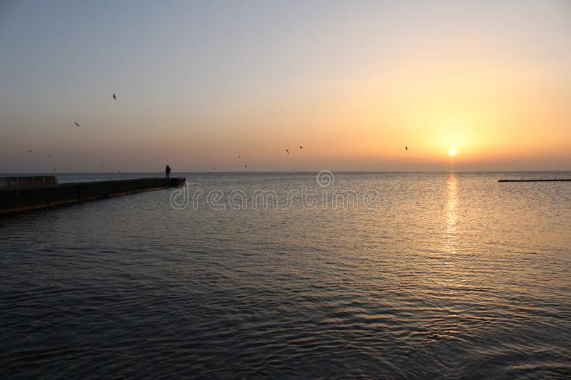 When you love the sunrise over the sea. You can get up in the morning and go for a walk to the sea, watch the sun rise, breathe the sea air, swim in warm or stock image