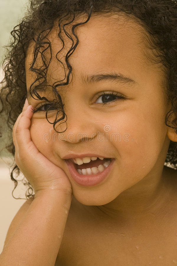 You Make Me Laugh. A beautiful mixed race girl with wet hair laughing at the camera royalty free stock photos