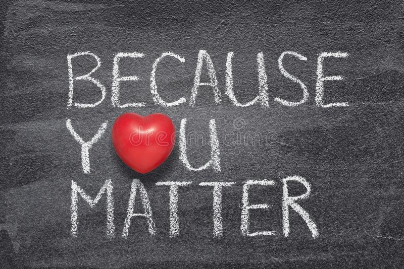 Because you matter. Phrase handwritten on chalkboard with red heart symbol instead of O royalty free stock photography