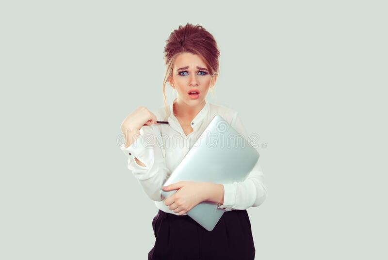 You mean me? Portrait angry unhappy annoyed young business woman holding laptop pointing with pen getting mad asking question you. Talking to me? Isolated light stock photos