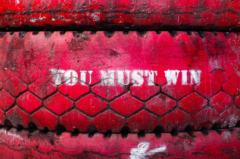 Inscription on the big old tire, colored in red. stock images