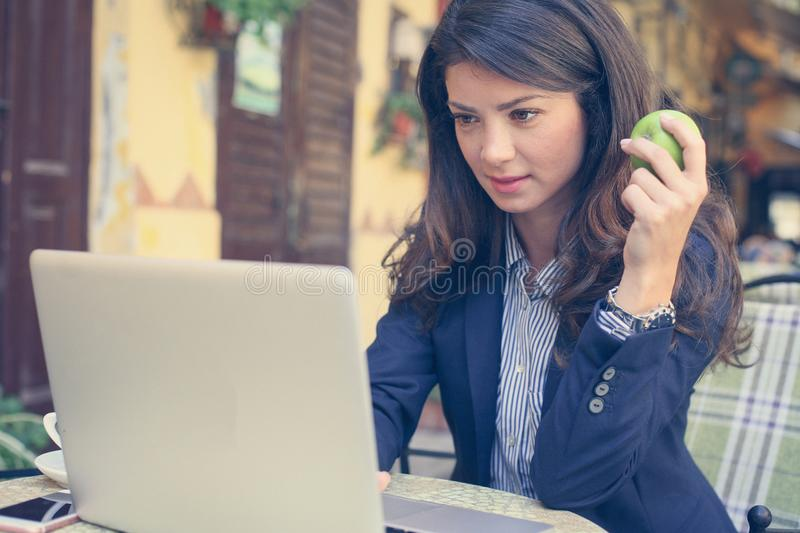 You need to live healthy, whatever is your job. Young woman royalty free stock images