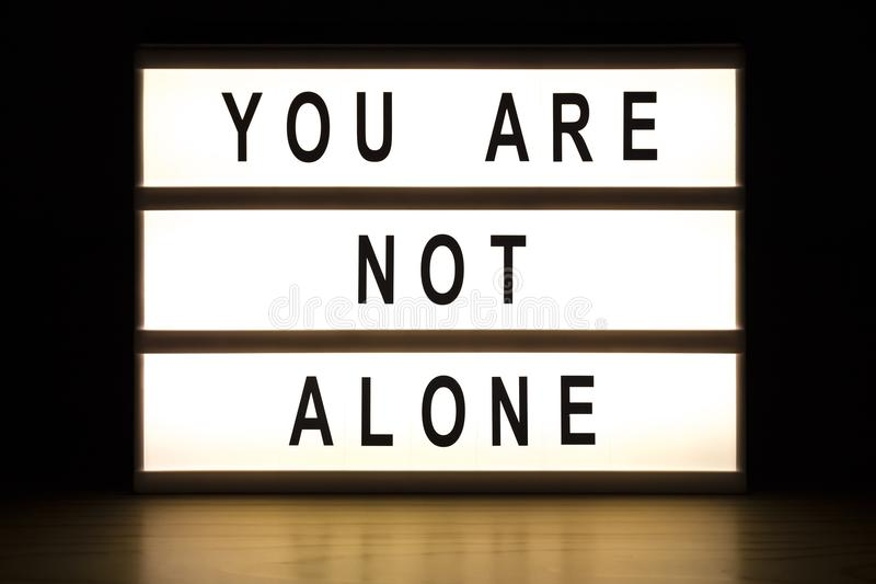 You are not alone light box sign board royalty free stock images