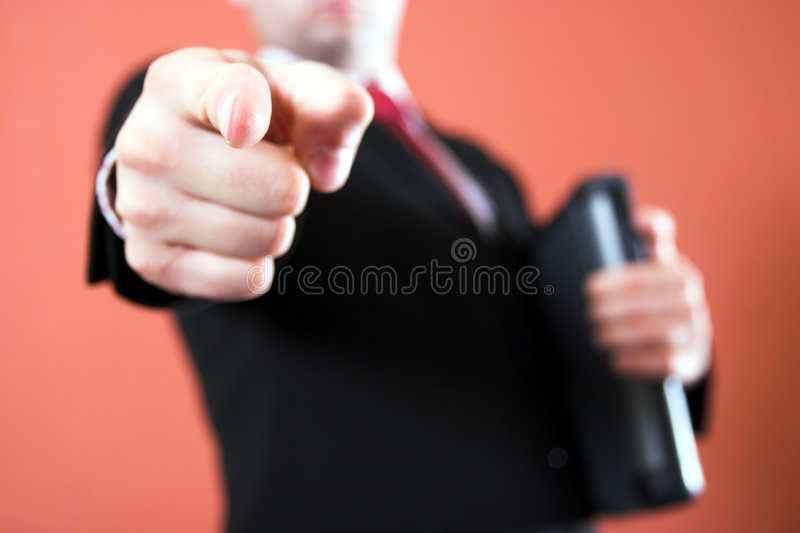 You are the one. Businessman pointing to the viewer and holding a laptop royalty free stock images
