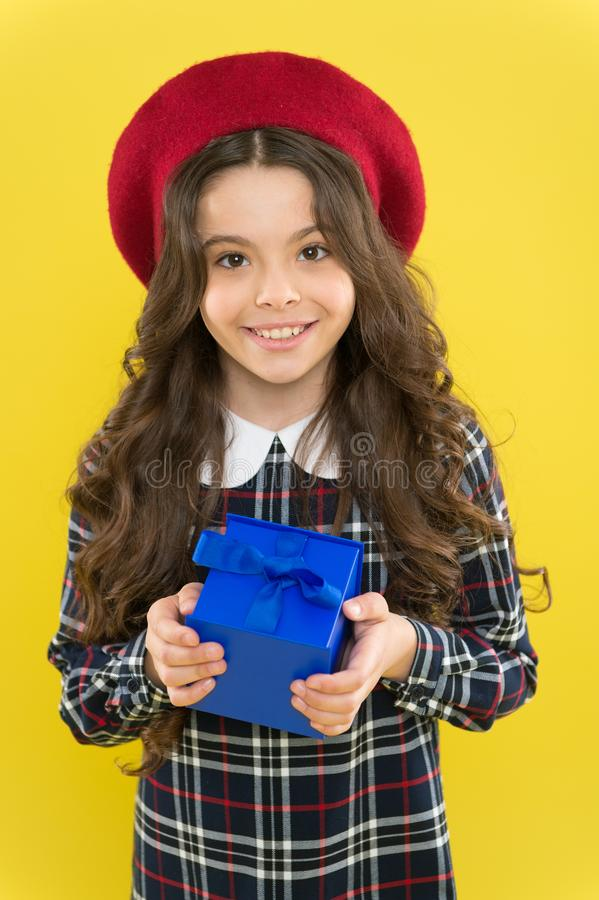 This is for you.parisian child on yellow background. happy birthday. . Holiday gift. shopping. child with present box. Happy girl with long curly hair in beret royalty free stock photos