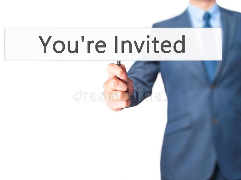 You& x27;re Invited! - Businessman hand holding sign royalty free stock photo