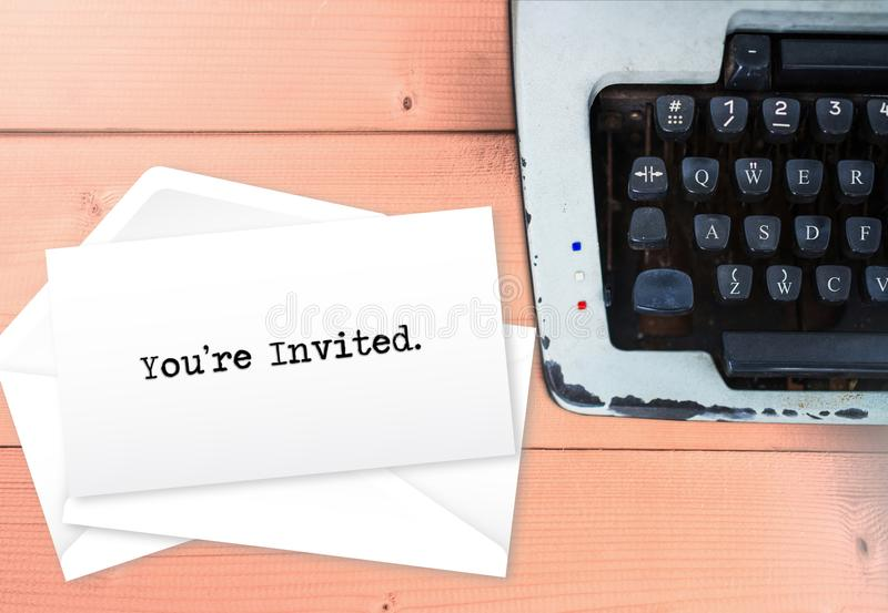 You`re invited on envelop letters stack with typewriter.  royalty free stock images