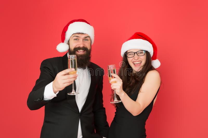 Are you ready. business couple drink champagne. xmas office party. they love new year. greetings concept. formal couple royalty free stock images