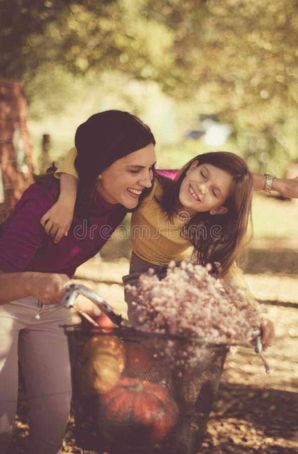 Are you ready for ride. ? Mother and daughter stock photography