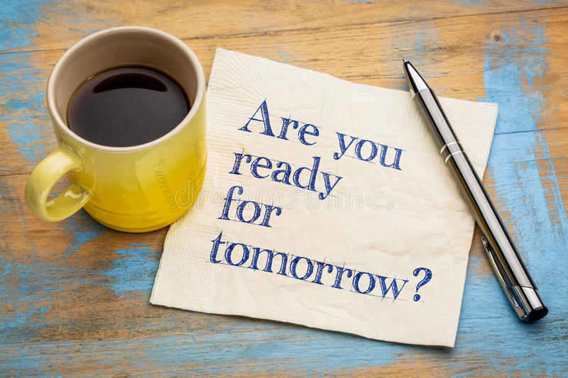 Are you ready for tomorrow?. Are you ready for tomorrow question - handwriting on a napkin with a cup of espresso coffee royalty free stock images