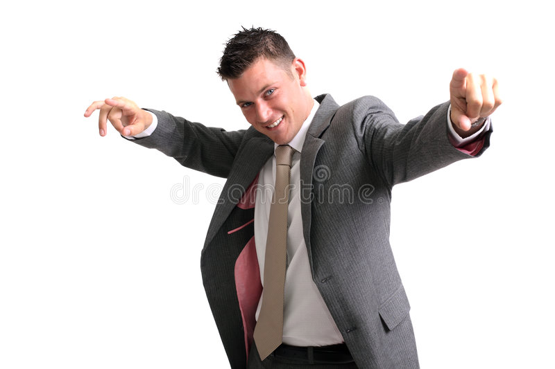 You rule!. Young cheerful businessman pointing forwards stock photo