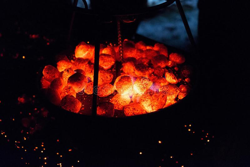 Glowing coal on top of a Dutch oven stock images
