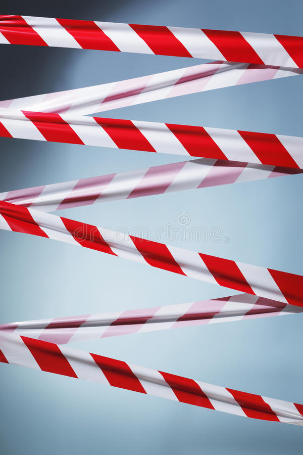 You shall not pass. Red and white plastic barrier tape blocking the way royalty free stock photography
