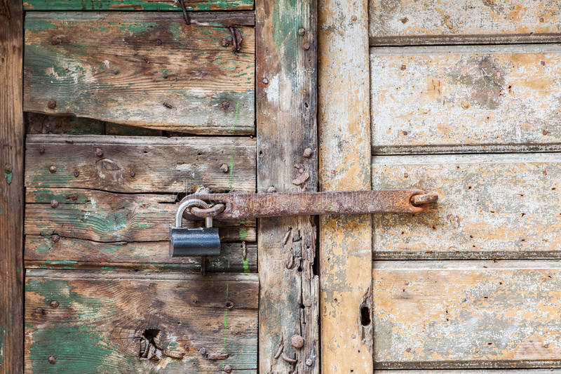 You shall not pass. Old door locked with old lock royalty free stock photo