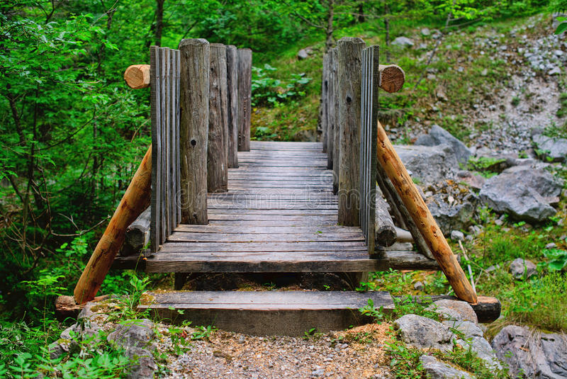 You shall not pass. Wooden Bridge on a mountain`s trail royalty free stock photos