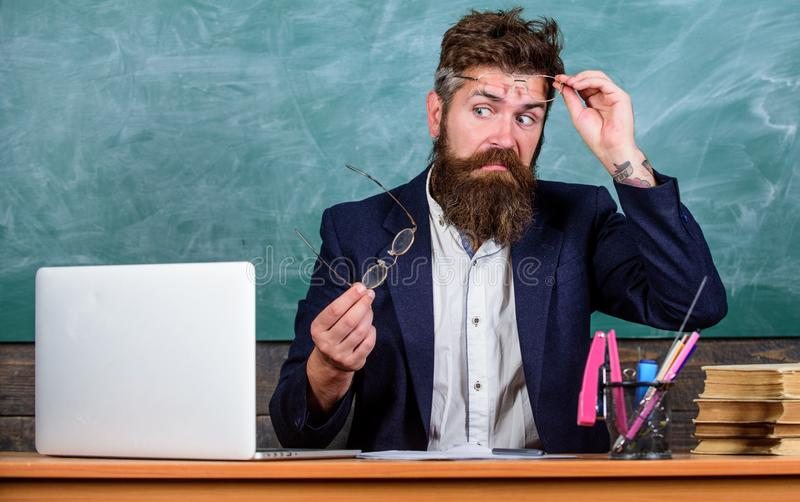 You should choose proper eyeglasses to keep good vision. Teacher bearded with eyeglasses care about eye health. Work royalty free stock images