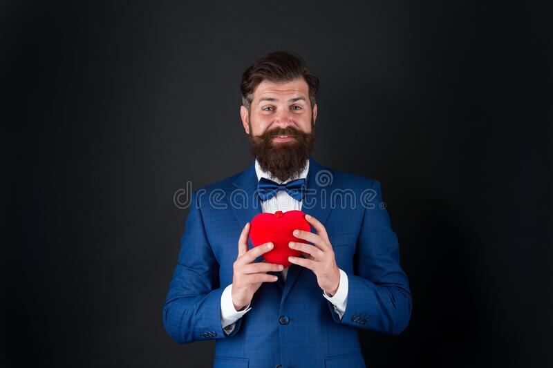 You should try it. businessman with bow tie. problems with heart. Romantic greeting. happy valentines day. tuxedo man royalty free stock images