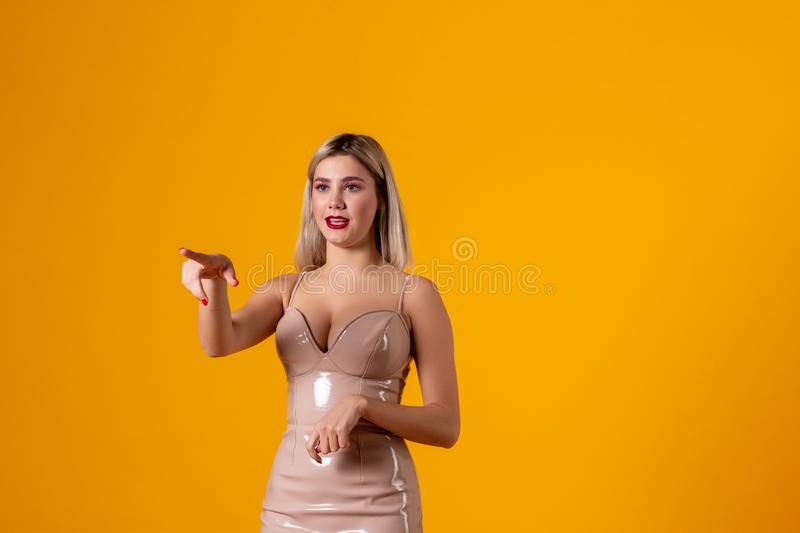 You should visit store in that direction. Pleased attractive blonde woman stock photo