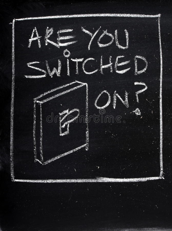 Are You Switched On?. The phrase Are You Switched On? on a blackboard next to a drawing of a light switch. Employers look for people who are alert and proactive stock photo
