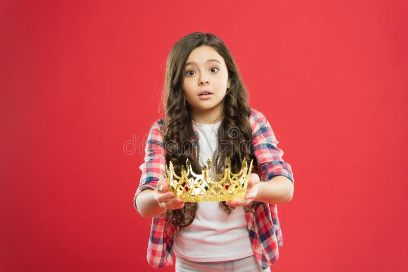 This is for you. Take it. Happiness and joy. Kid wear golden crown symbol of princess. Girl cute baby wear crown. Become stock photography
