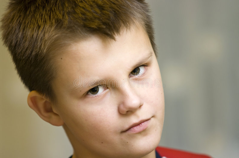 You talking to me?. A teenage boy portrait, a serious stare in his face royalty free stock photos