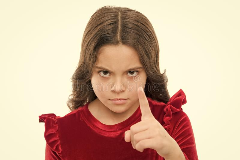 You are warned. Girl kid threatening with fist isolated on white. Strong temper. Threatening with physical attack. Kids. Aggression concept. Aggressive girl stock photo