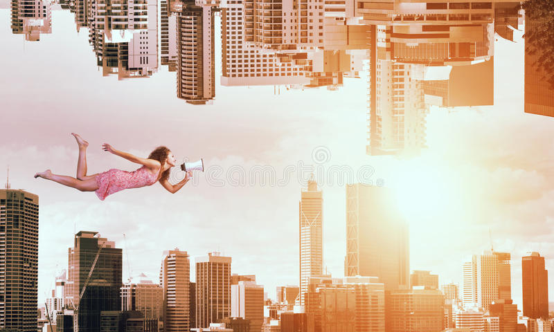 When you are young and free. Young woman flying between two reality worlds stock images