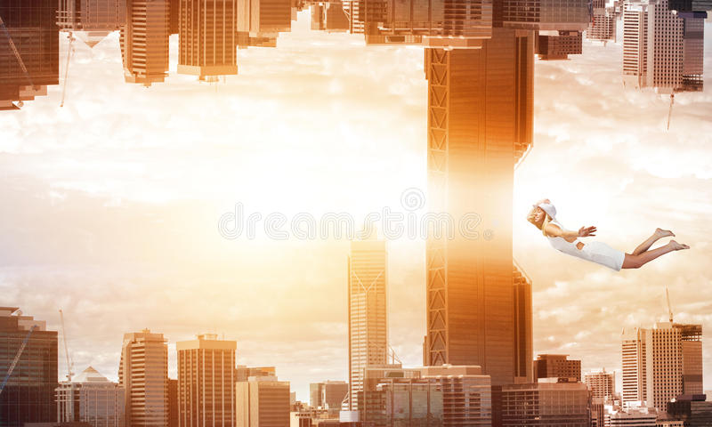 When you are young and free. Young woman flying between two reality worlds stock photo
