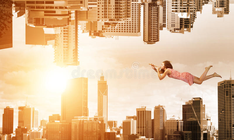 When you are young and free. Young woman flying between two reality worlds royalty free stock photo