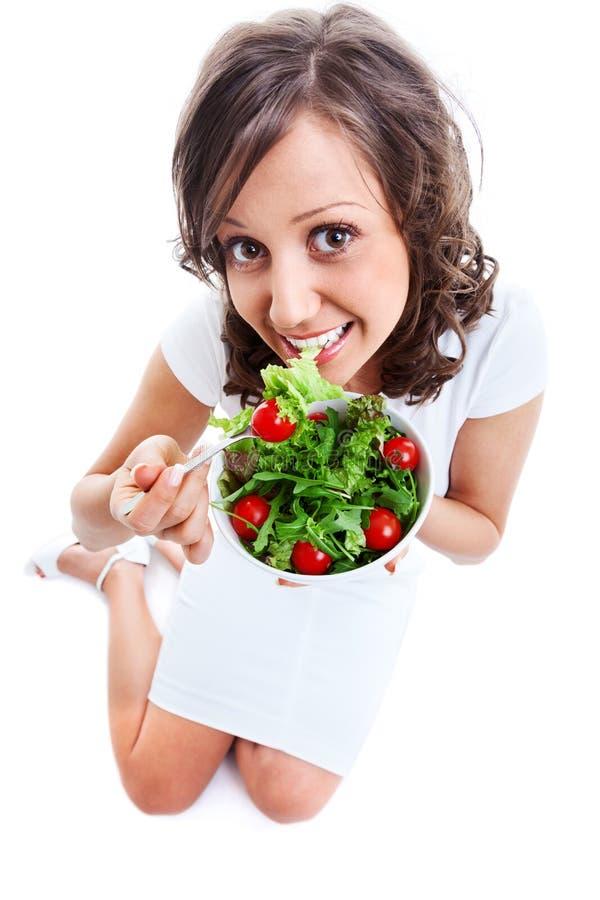 Youg kobieta je zdrowej sałatki zdjęcie royalty free