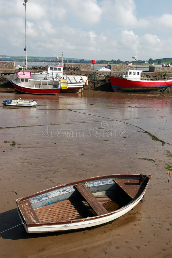 Youghal harbour. A calm sea on the west coast of ireland with boats anchored in the bay stock image
