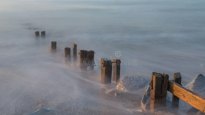 Youghal Strand Groynes 25092017. Long exposure shot off the incoming tide on Youghal strand at dawn stock images