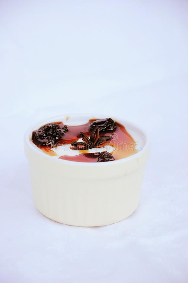 Yougurt cream with cherry sauce royalty free stock images