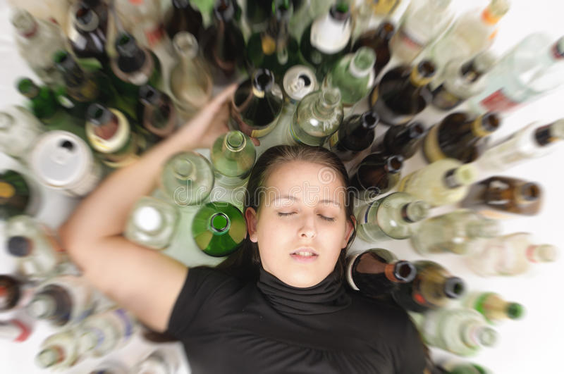 Yound beautiful woman in depression, drinking alcohol royalty free stock photos