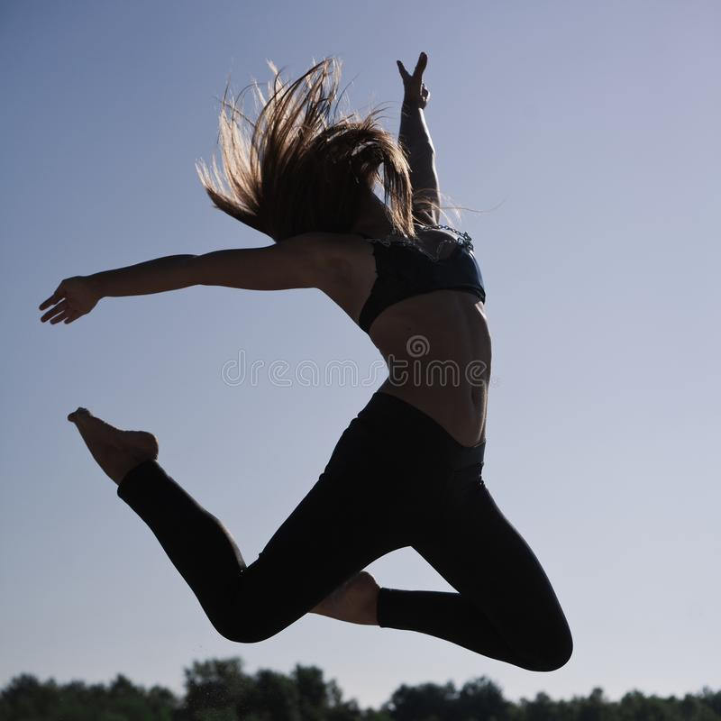 Young acrobatic girl royalty free stock photography