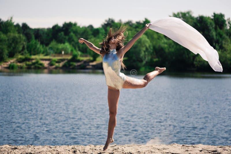 Young acrobatic girl stock photo