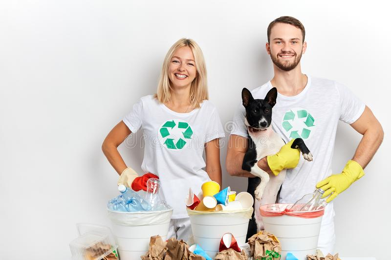 Young active ambitious volunteers taking care of animals and nature stock image