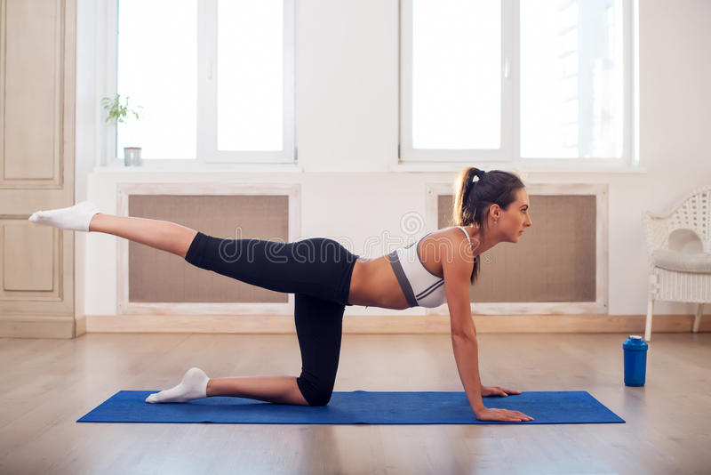 Young active athletic sporty slim woman doing yoga royalty free stock photos
