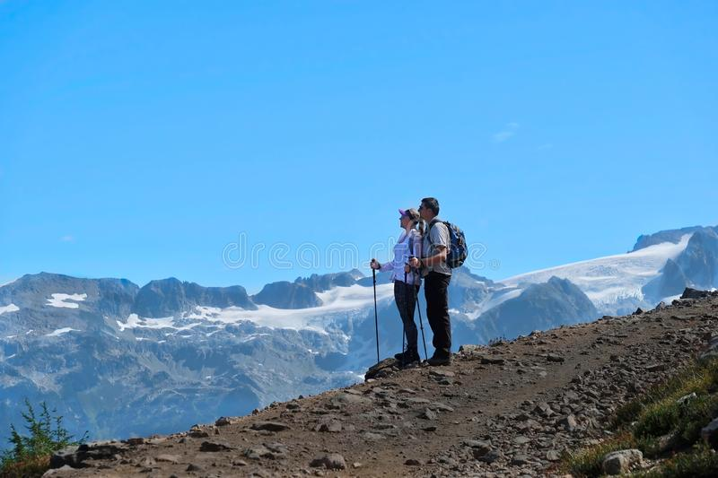Young active couple hiking in mountains in Pacific Northwest. royalty free stock images