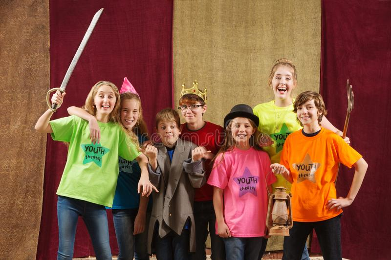 Young actors pose with costume pieces royalty free stock photography
