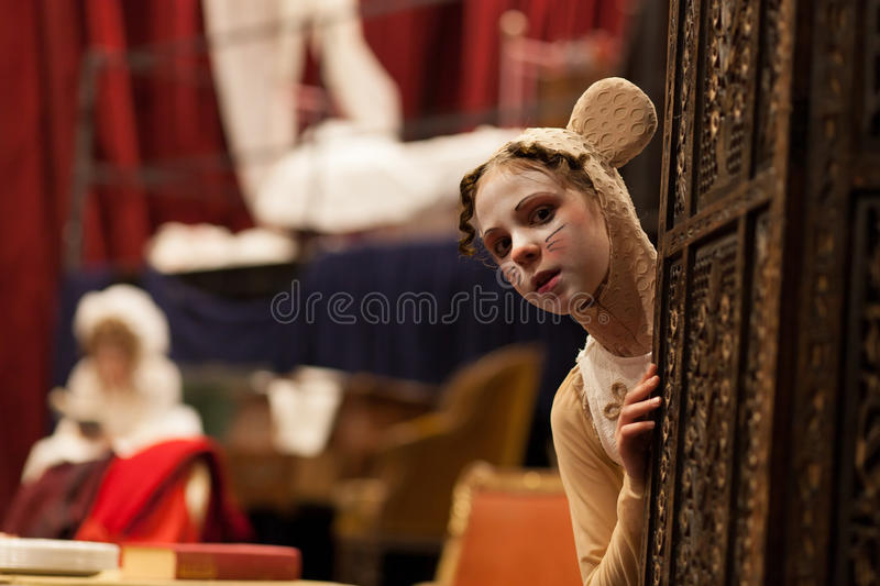 Young actress in a mouse costume. Behind the scene stock photo