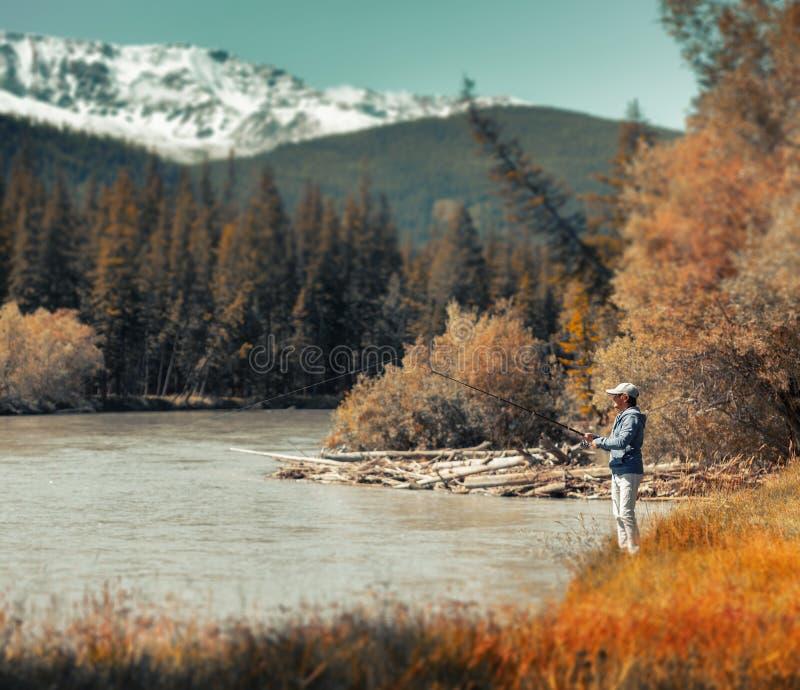 Young adult angler stock photos