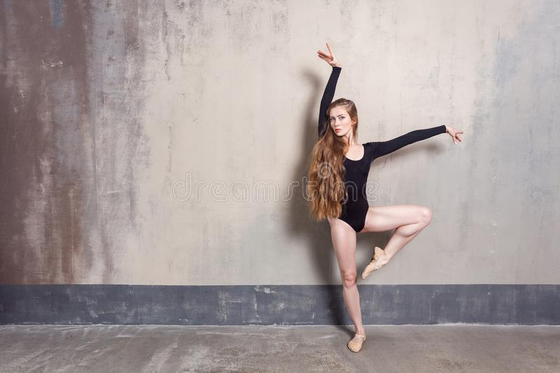 Young adult ballet dancer posing in studio. Contemporary dance p stock image