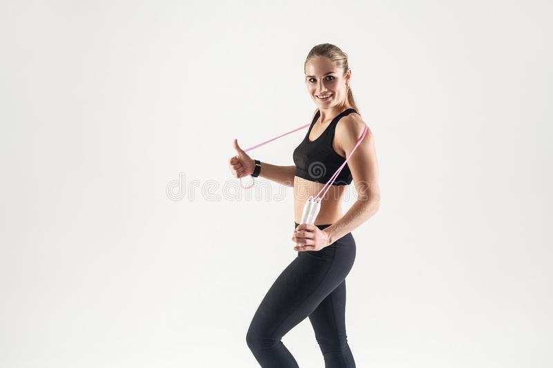 Healthy lifestyle. Young adult blonde caucasian girl holding a r royalty free stock photo